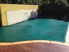 green pool debris cover with feature wall