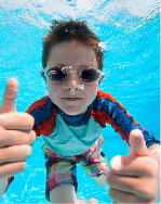 image of a boy in a pool giving the thumbs up
