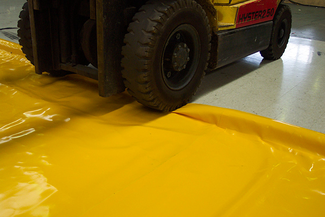 image showing a spillsafe portable drive over spill bund and forklift