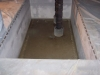 Water proof termination of a liner at a sump in a tank
