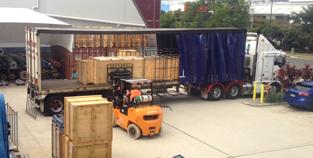 Swimming pool liner for Hayman Island being loaded onto a truck, 2104.