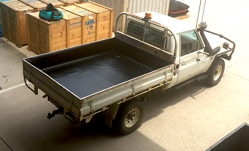 image showing a containment liner in the back of a ute